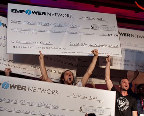 david-wood-david-sharpe-holding-income-check-empower-network
