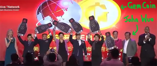 john-wuo-on-stage-gemcoin-usfia-event